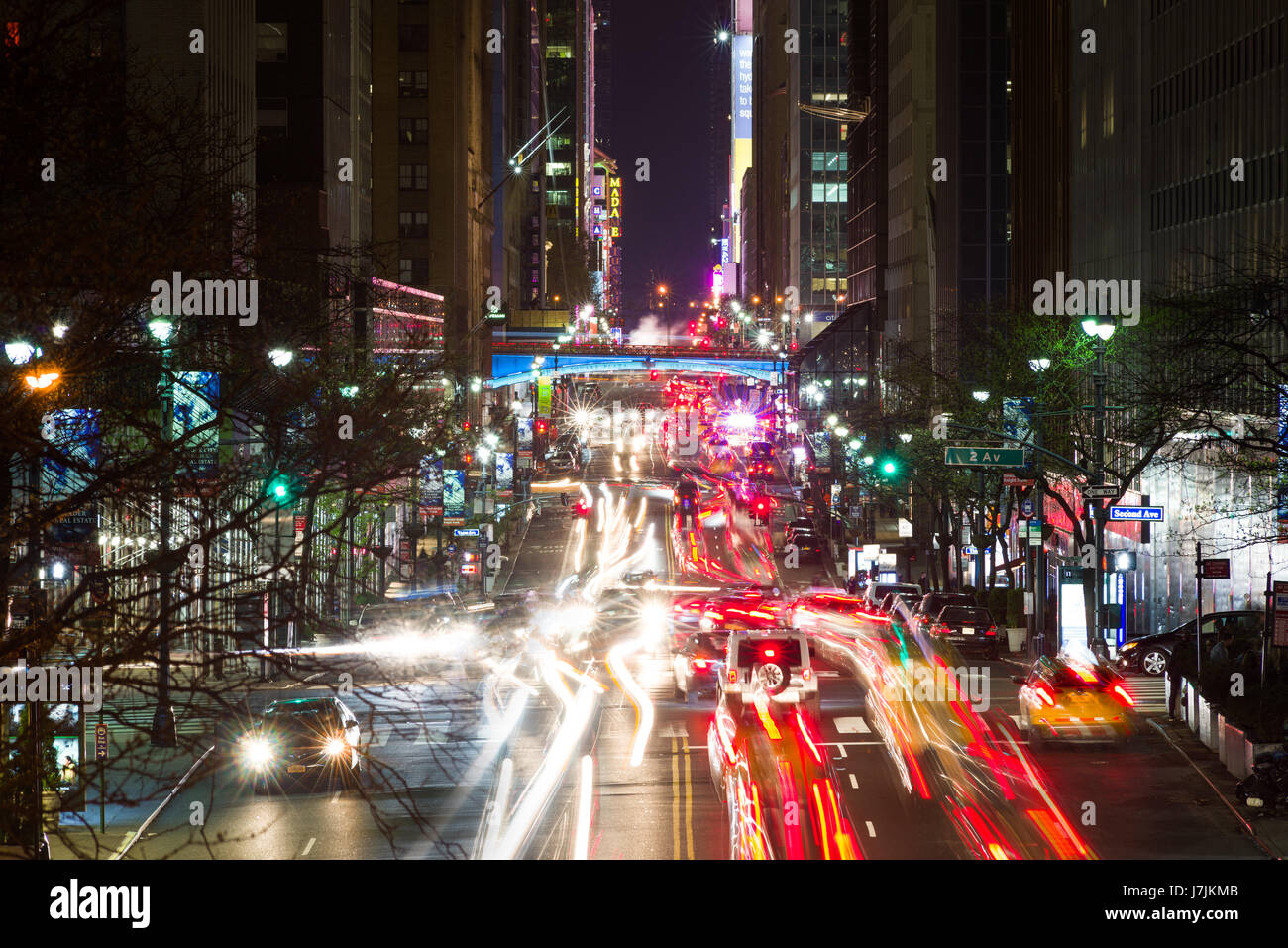 Night Time Long Exposure View Down 42nd Street To Pershing Square With Busy Traffic On Road, New York - Stock Image