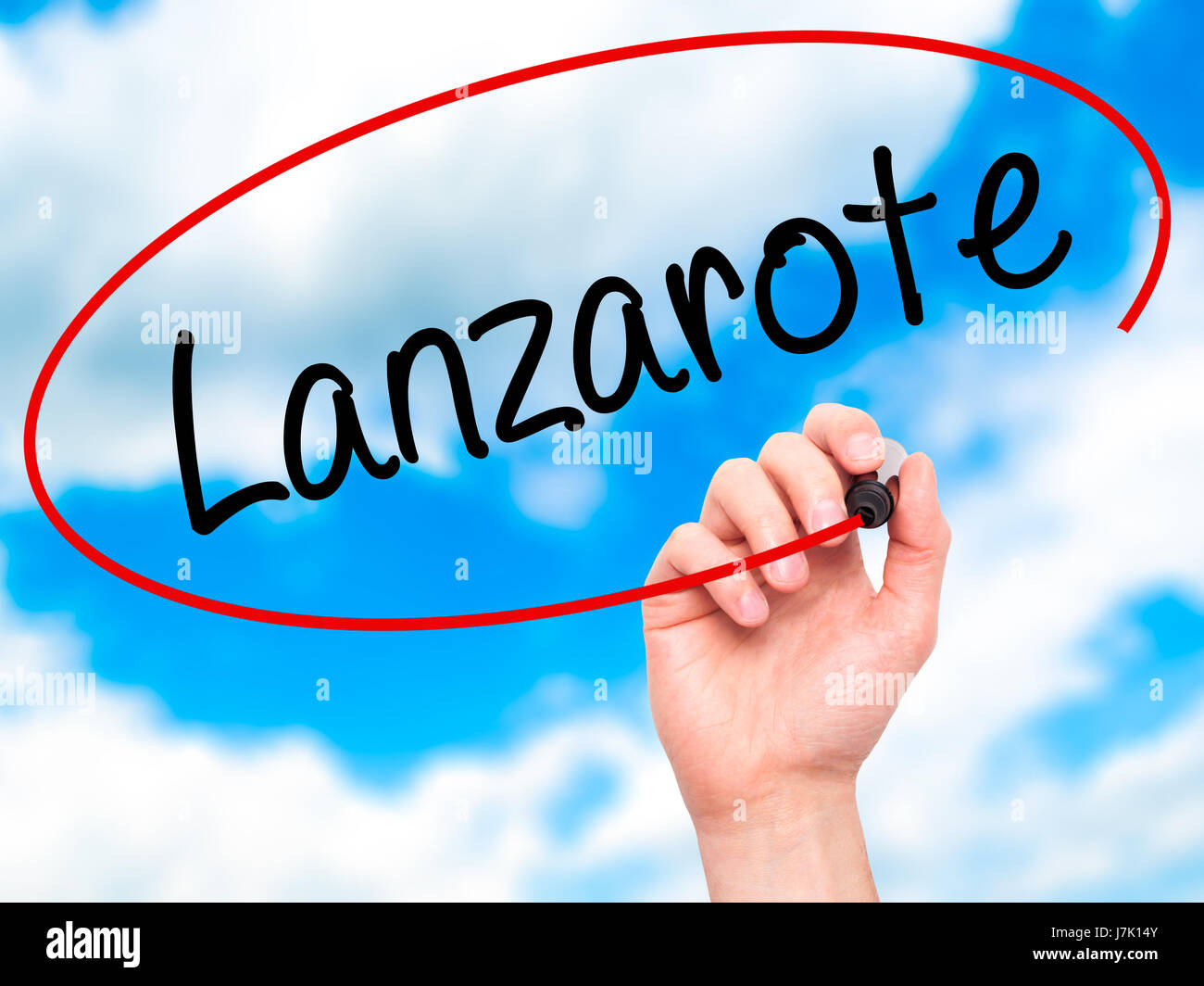 Man Hand writing Lanzarote with black marker on visual screen. Isolated on background. Business, technology, internet Stock Photo