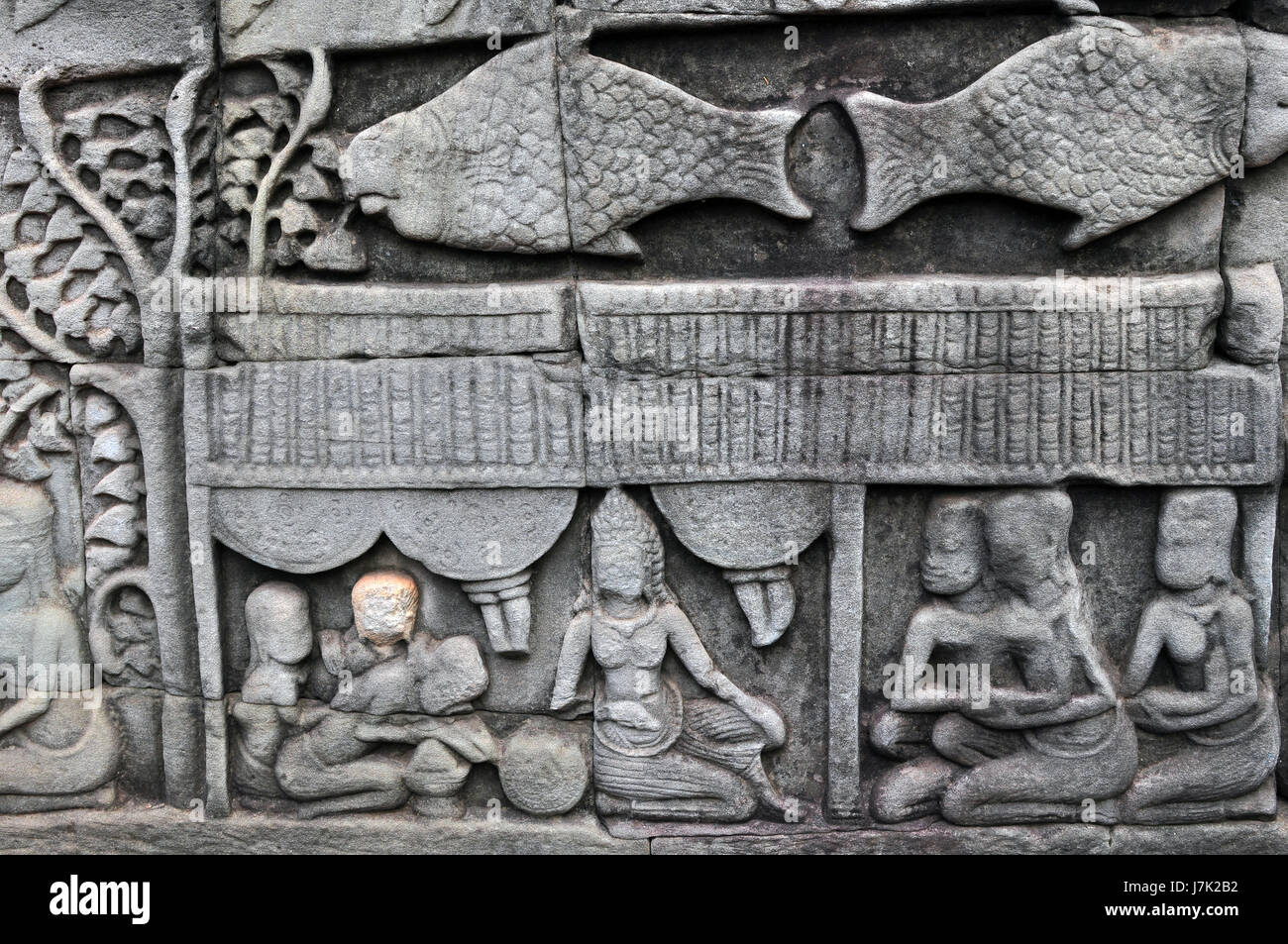 Stone wall carvings from the ancient city of angkor thom cambodia