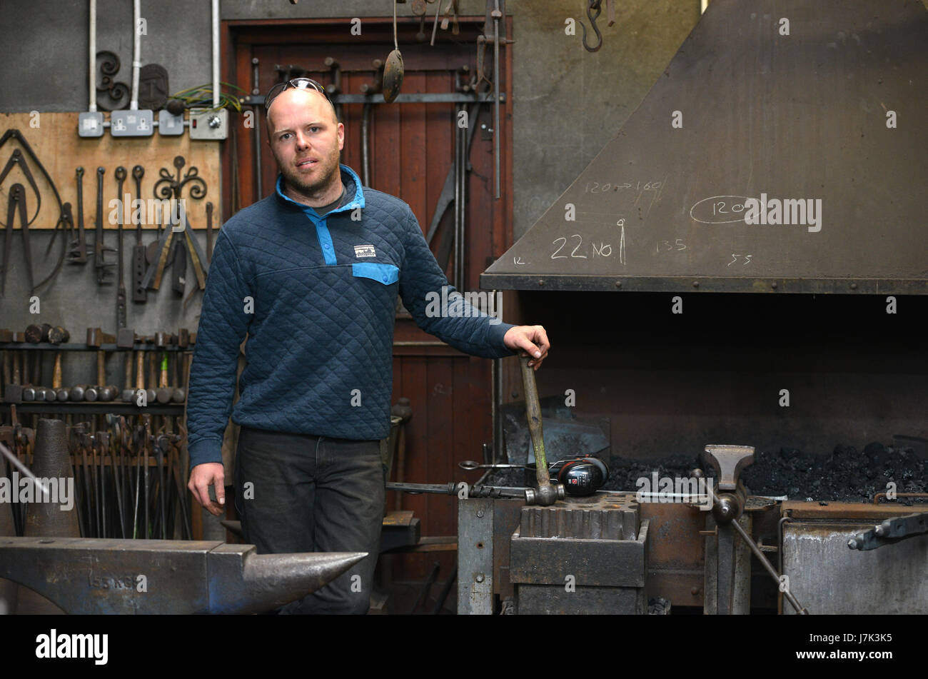 Blacksmith, James Price, in his forge, East Chiltington, East Sussex - Stock Image