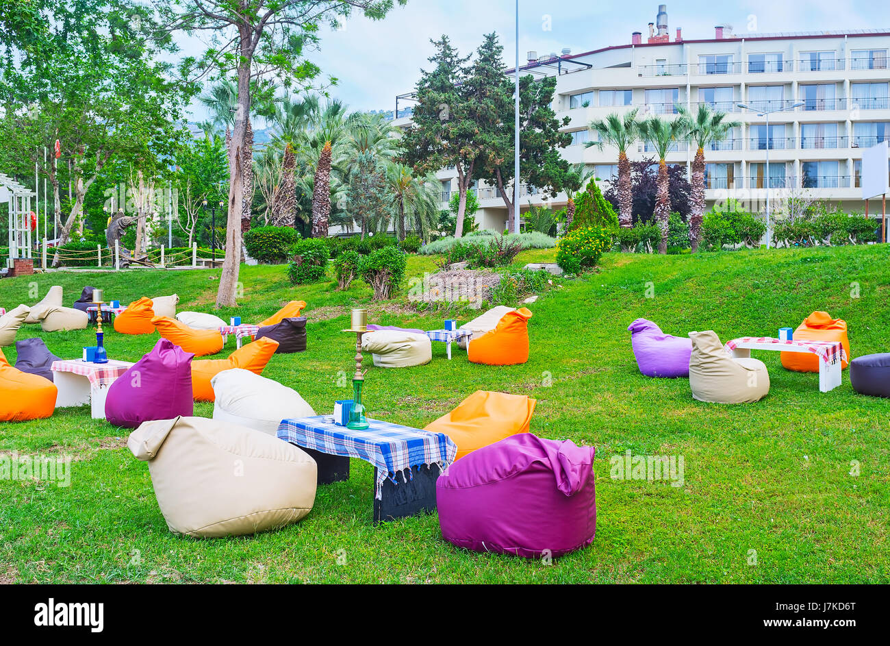 The lovely outdoor lounge cafe with colorful bean bag chairs and shishas on tables, Kemer, Turkey. - Stock Image