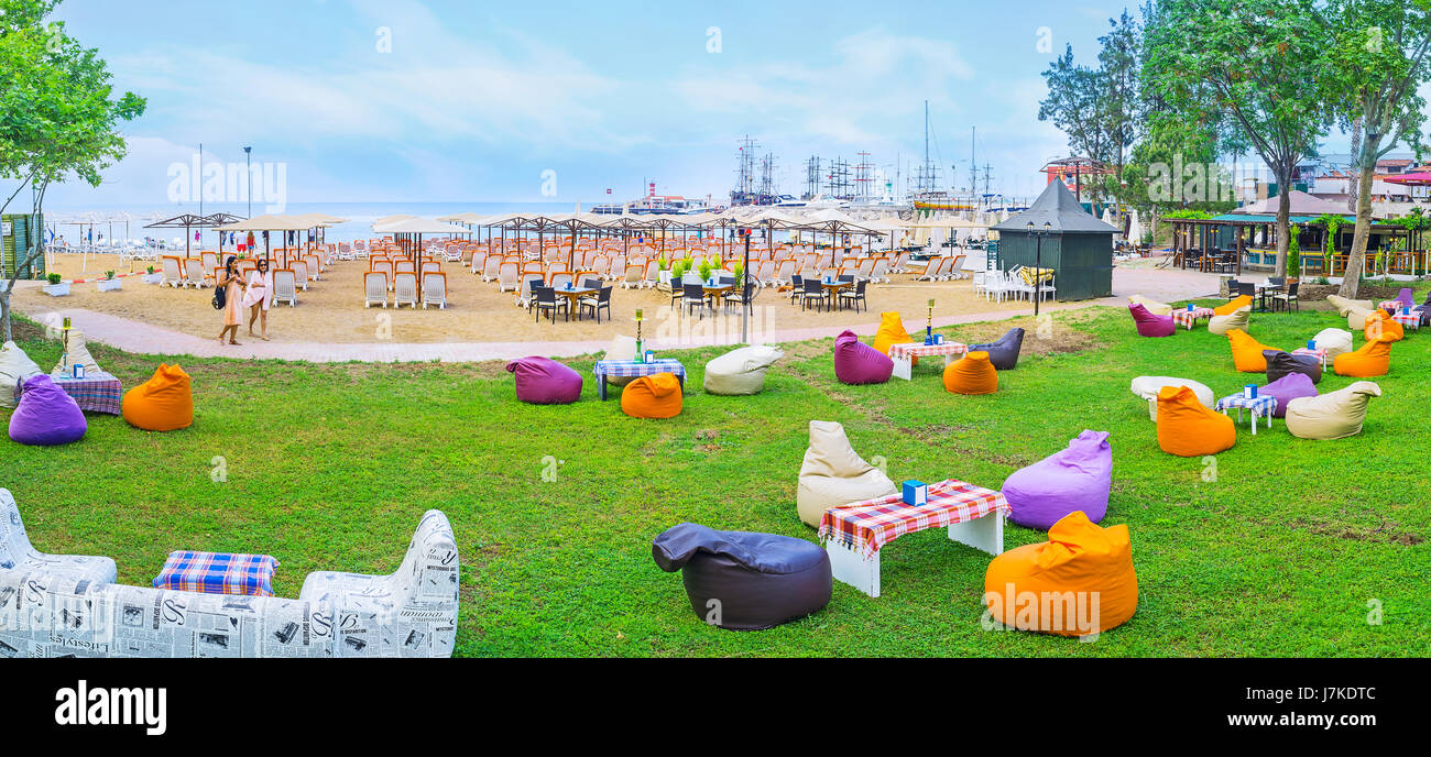 KEMER, TURKEY - MAY 5, 2017: Panorama of the lounge zone at the Moonlight beach with comfortable sun beds on the - Stock Image