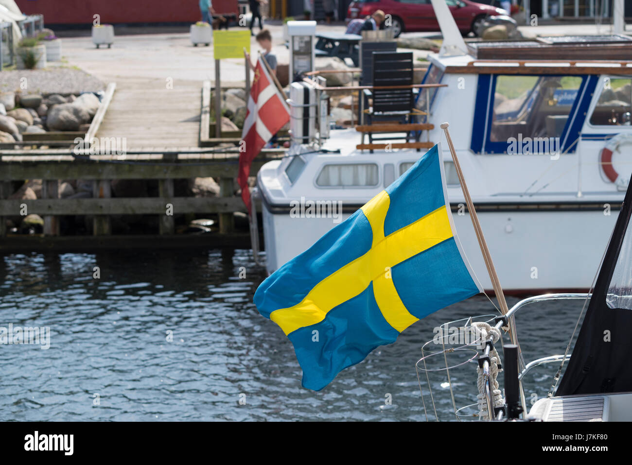 small swedish flag on a yacht in the Hundested harbor in Denmark - Stock Image