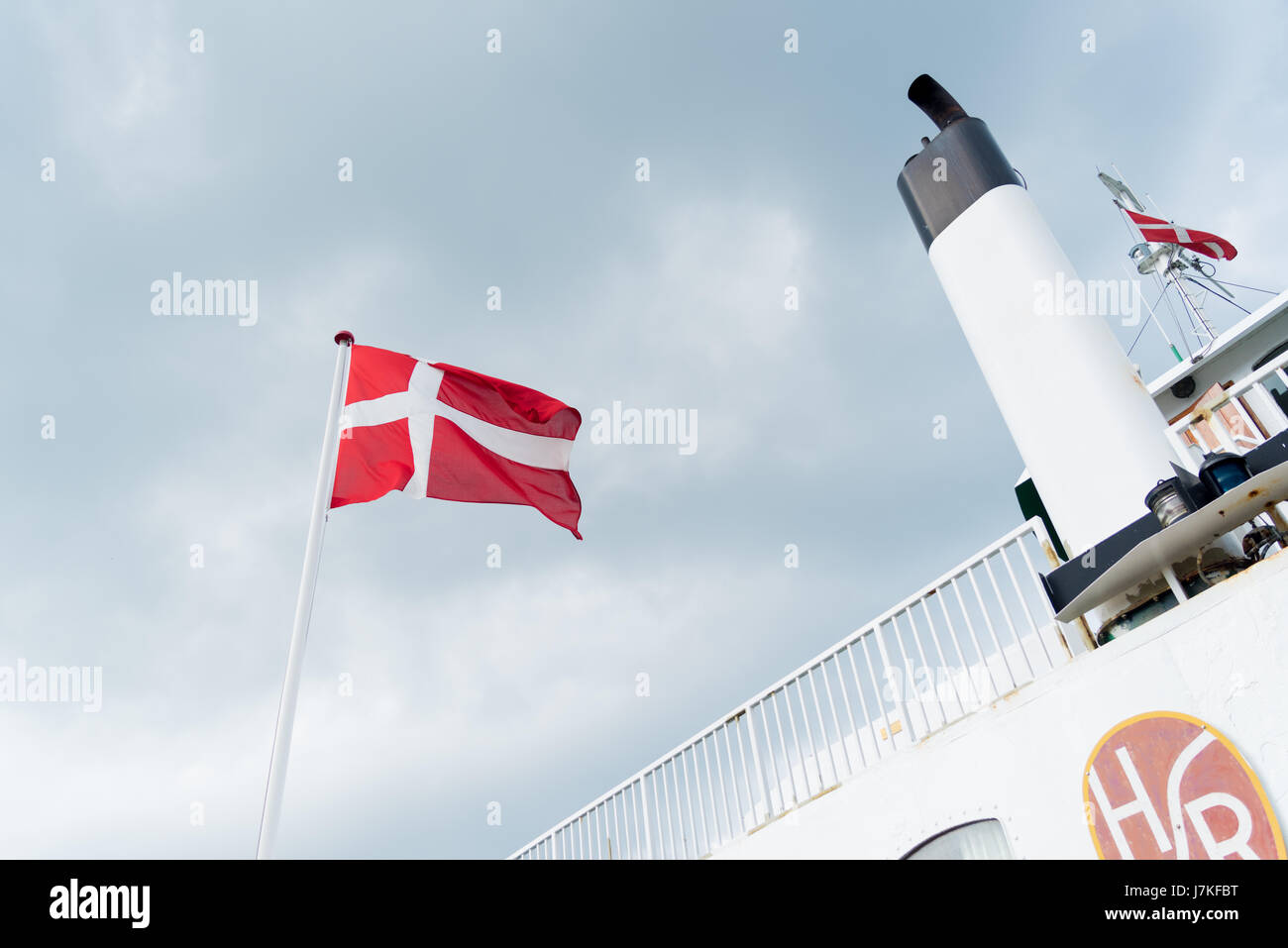 HUNDESTED, DENMARK - AUGUST 8, 2016: Danish flag on the Hundested - roervig ferryboat - Stock Image