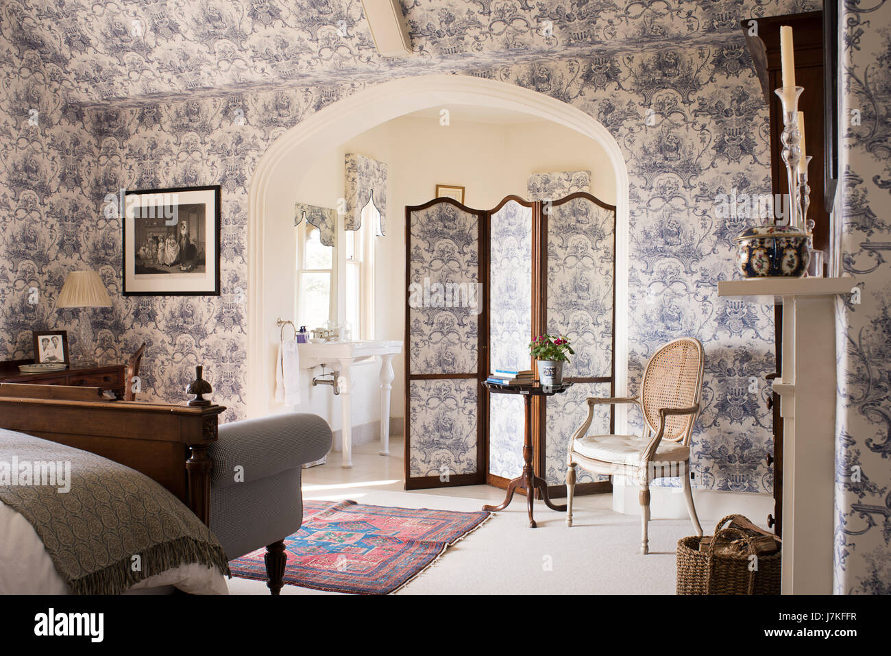 Large Ensuite Bedroom With Toile De Jouy Wallpaper And Matching Folding  Screen.