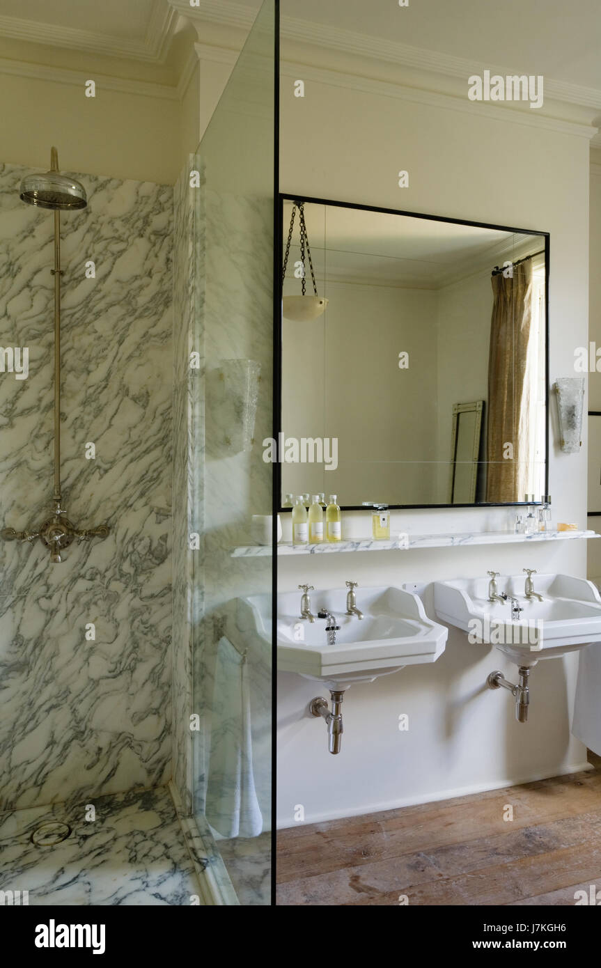 Marble Shower Unit With Large Mirror Above Double Basins In Portland Road,  London, UK