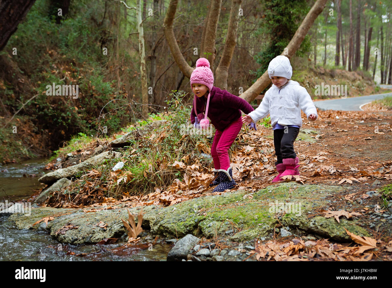 Young Children Looking At The Stream Flowing - Stock Image