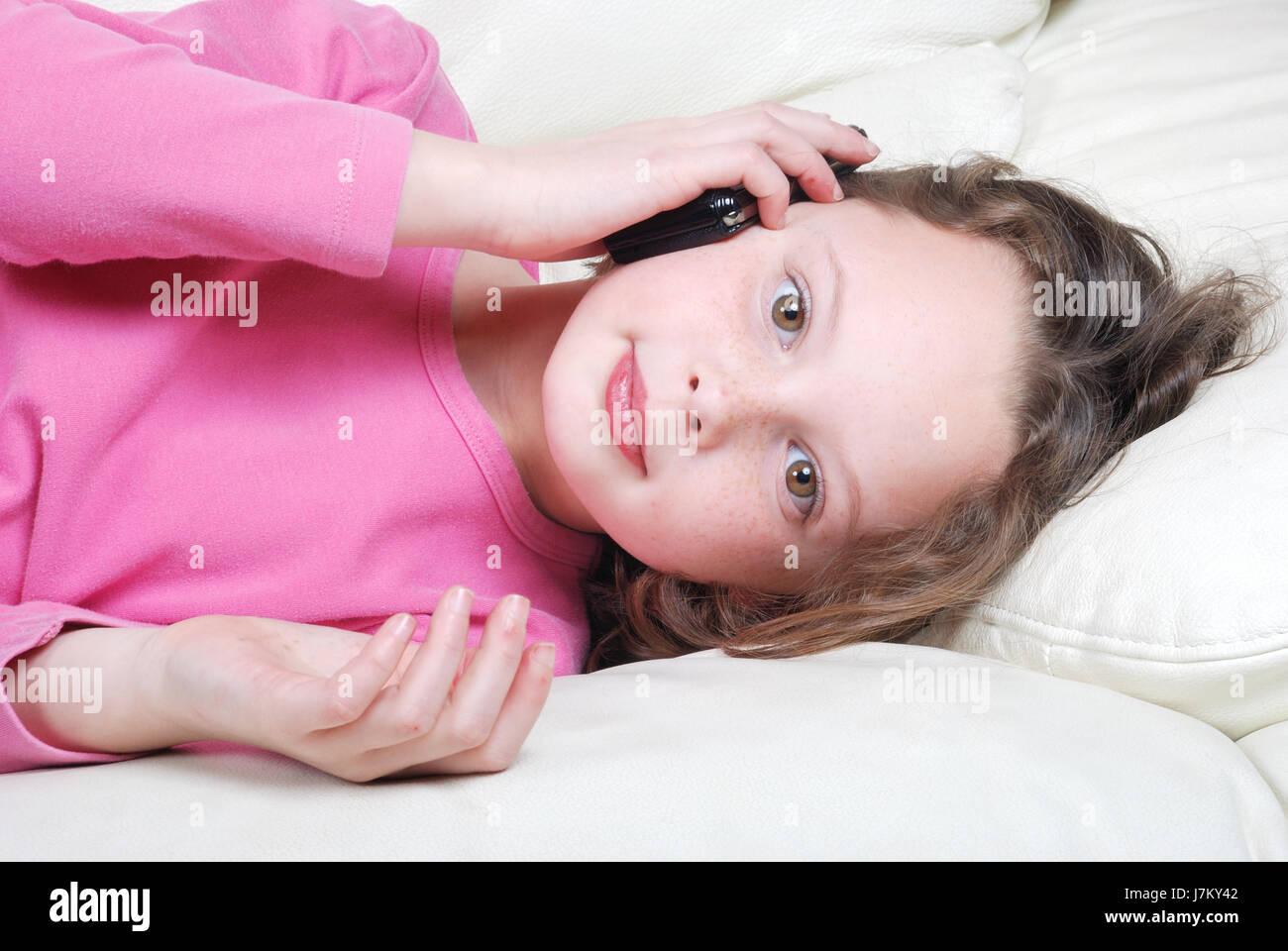 telephone phone talk speaking speaks spoken speak talking chat nattering sofa - Stock Image