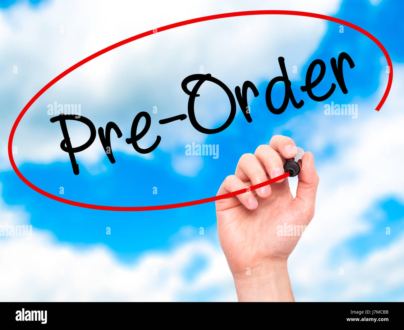 Man Hand writing Pre-Order  with black marker on visual screen. Isolated on background. Business, technology, internet - Stock Image