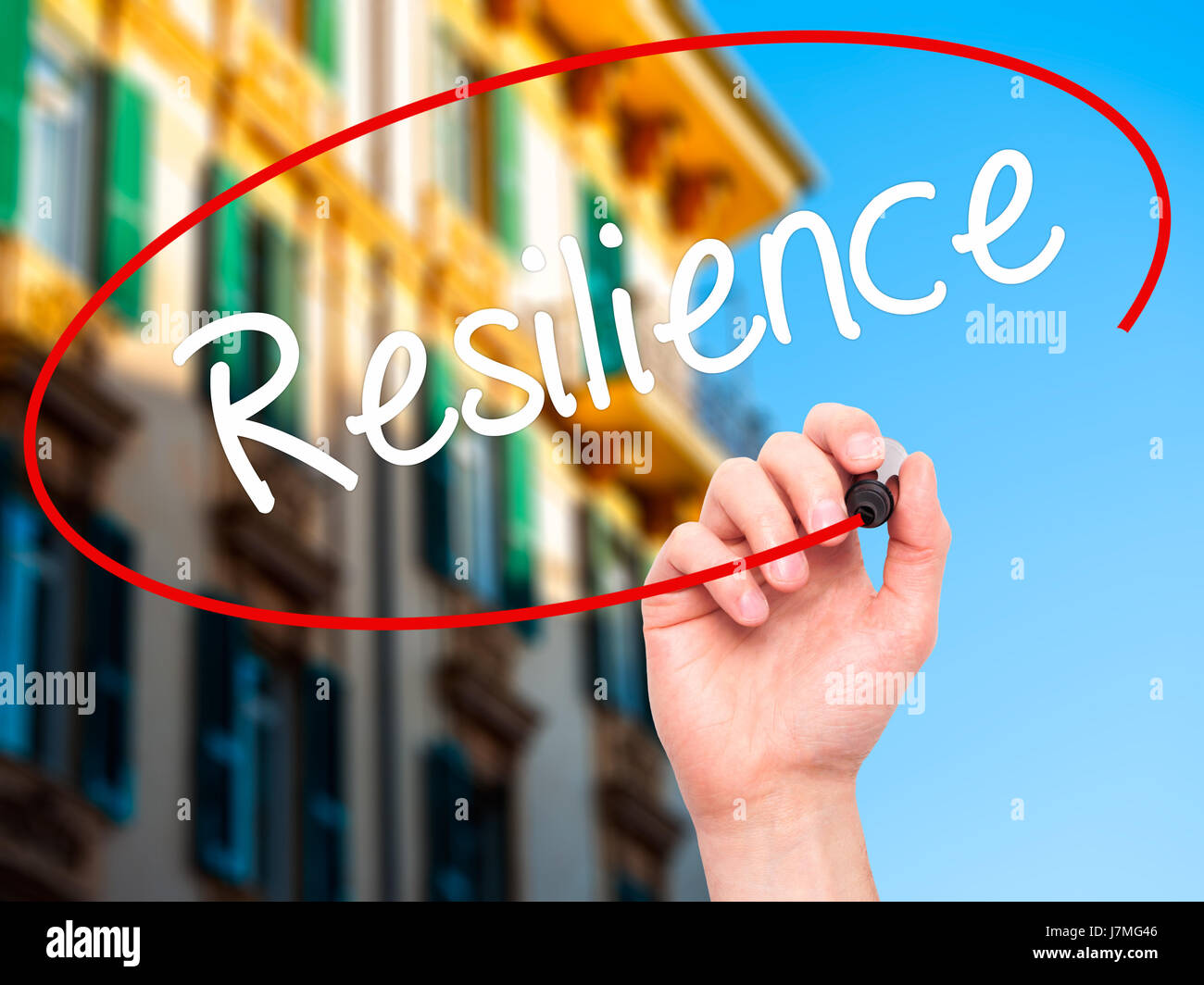 Man Hand writing Resilience with black marker on visual screen. Isolated on city. Business, technology, internet - Stock Image