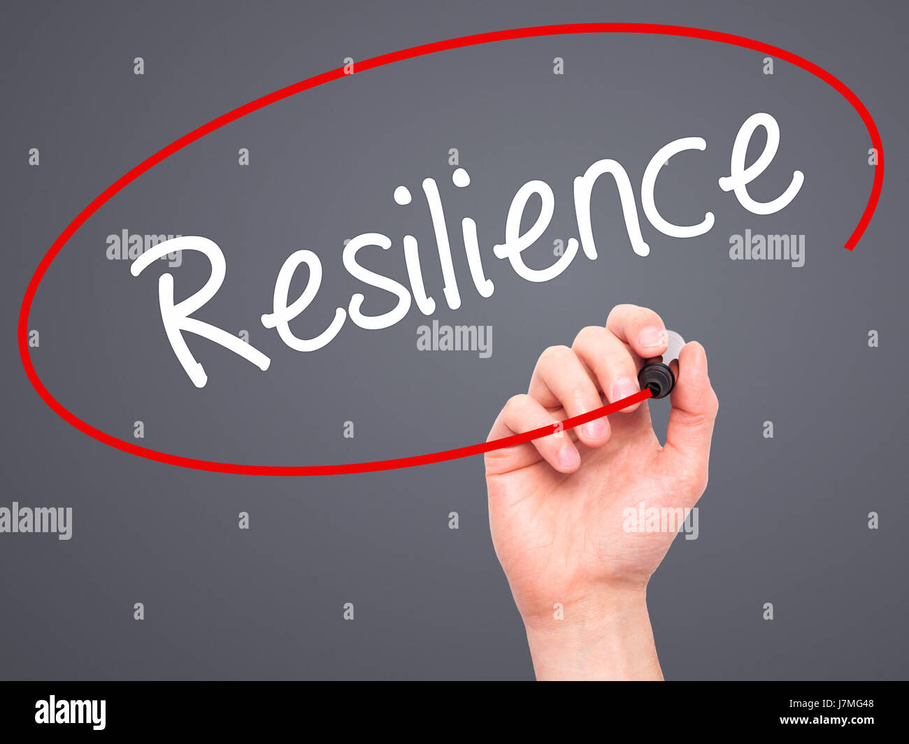 Man Hand writing Resilience with black marker on visual screen. Isolated on grey. Business, technology, internet - Stock Image