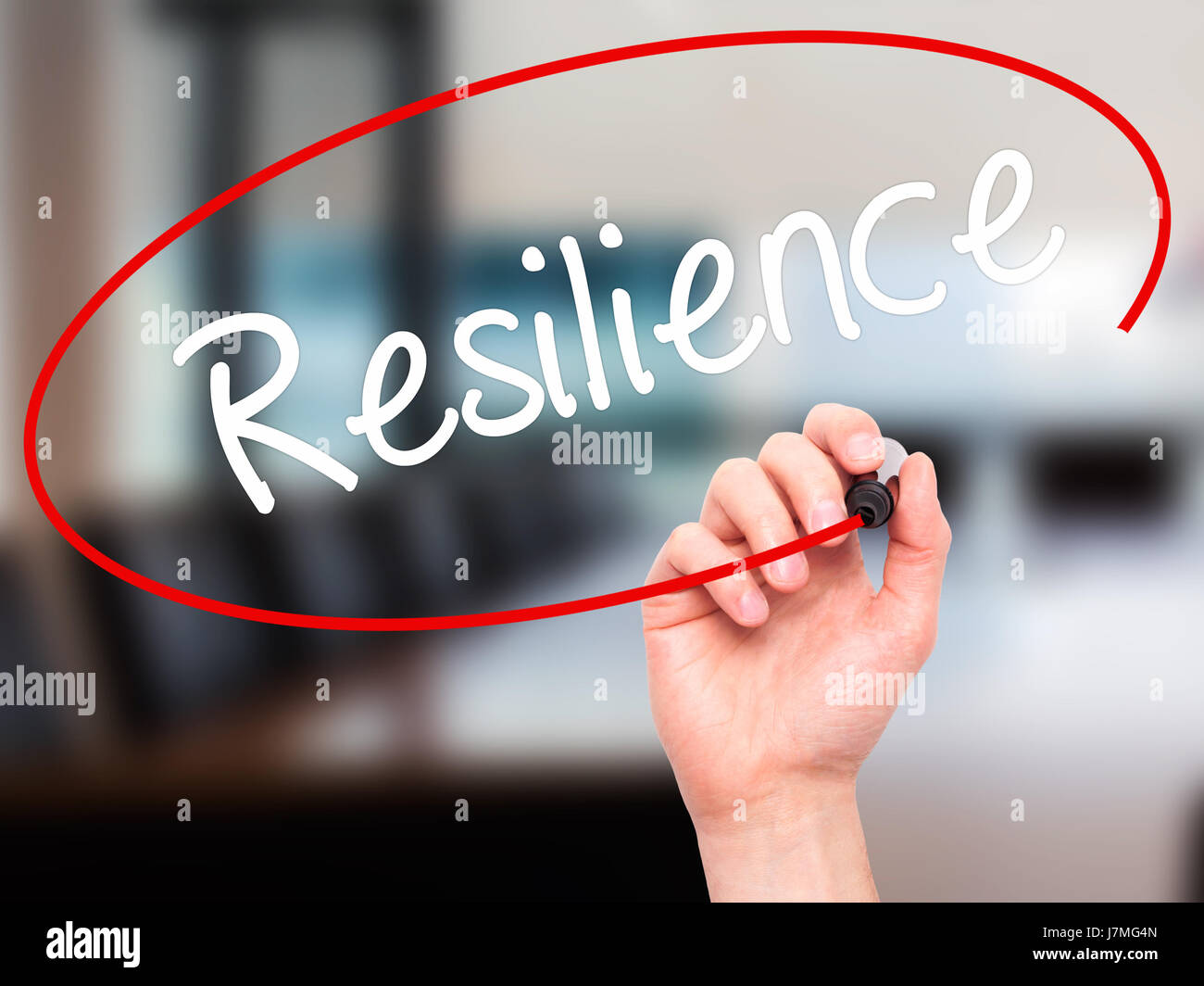 Man Hand writing Resilience with black marker on visual screen. Isolated on office. Business, technology, internet - Stock Image