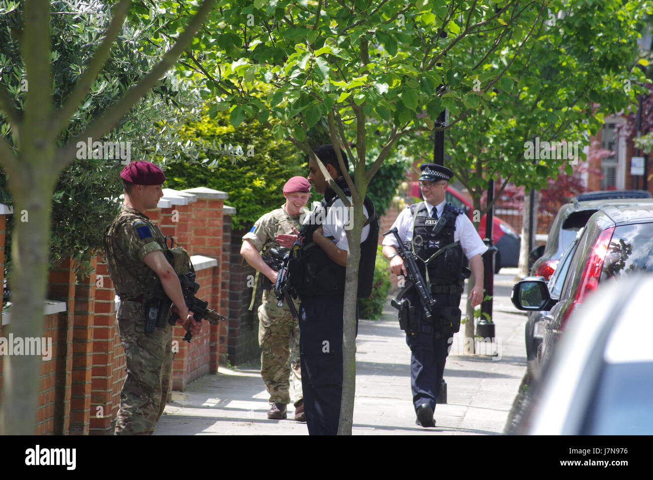 London, United Kingdom. 25th May, 2015.Heavily armed military personnel and armed police guard London streets, United - Stock Image