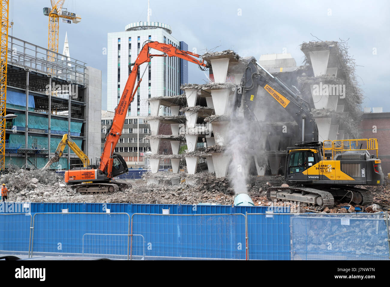 Demolition of derelict buildings on construction site at Wood Street carpark near station Central Square, Cardiff Stock Photo