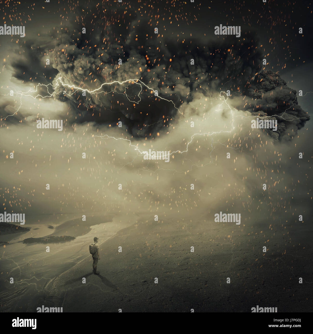 Surreal view as a young boy, stand on the sandy ground near the seaside watching a hurricane, sandstorm coming with - Stock Image