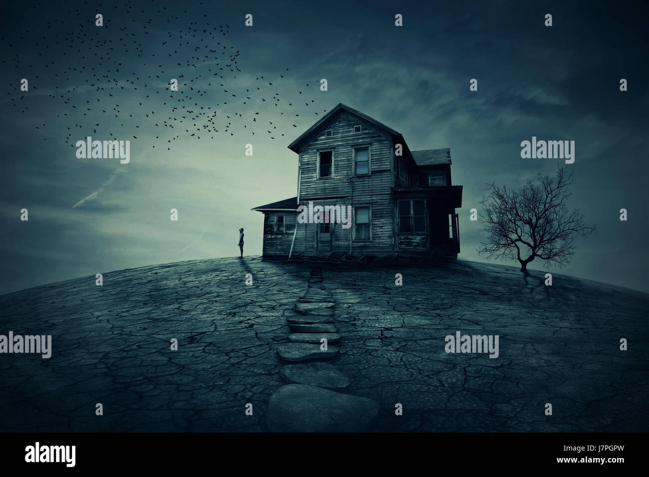 Young man stand at the corner of a ravaged house, looking far away for someone. A ghost, desolated house with a - Stock Image