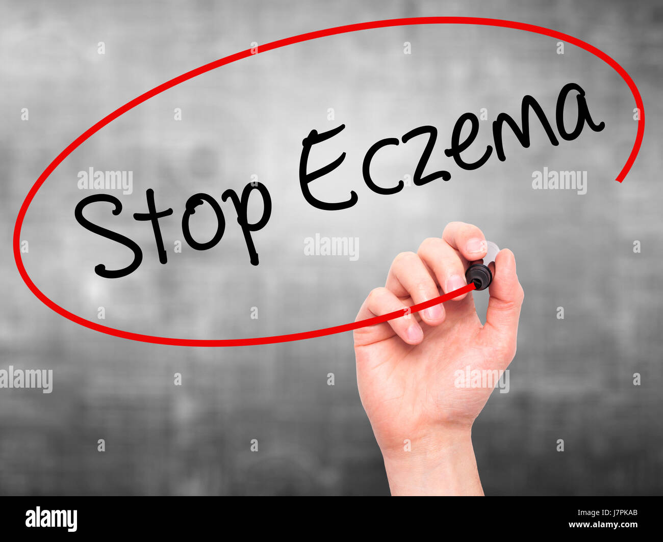 Man Hand writing Stop Eczema with black marker on visual screen. Isolated on grey. Business, technology, internet Stock Photo
