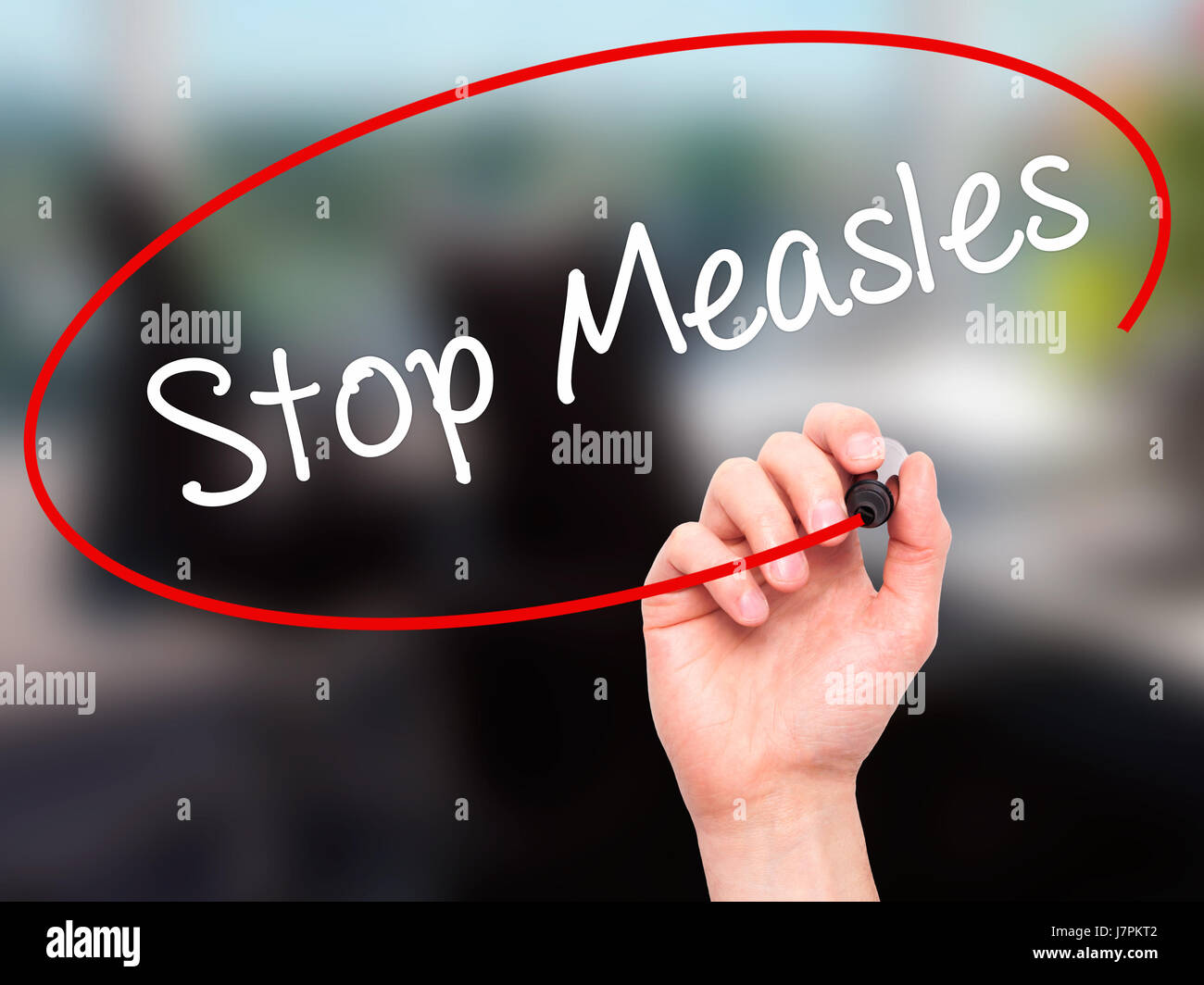 Man Hand writing Stop Measles  with black marker on visual screen. Isolated on background. Business, technology, - Stock Image