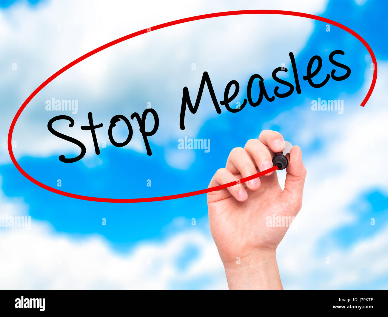 Man Hand writing Stop Measles  with black marker on visual screen. Isolated on background. Business, technology, Stock Photo