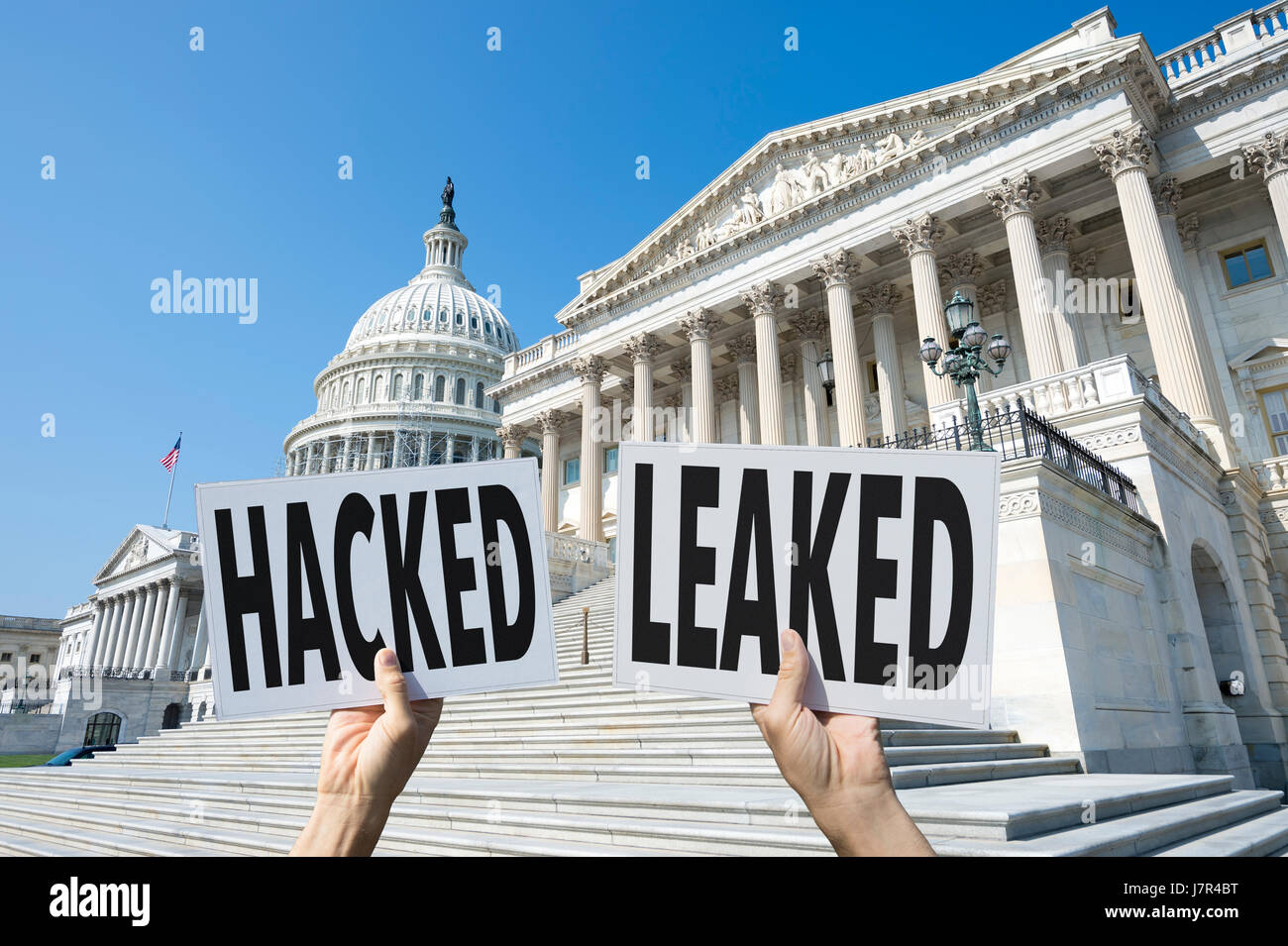 Signs representing issues with modern elections, the hacking of accounts and leaking of information, at the US Capitol - Stock Image