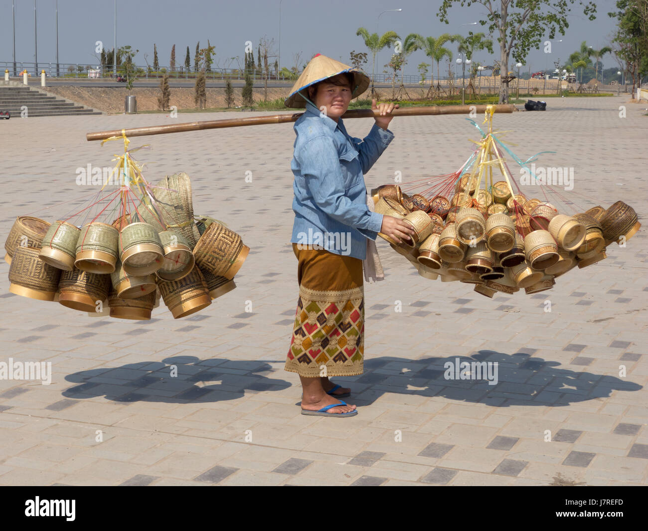 asia saleswoman woman asia portrait human human being basket tradition sale - Stock Image
