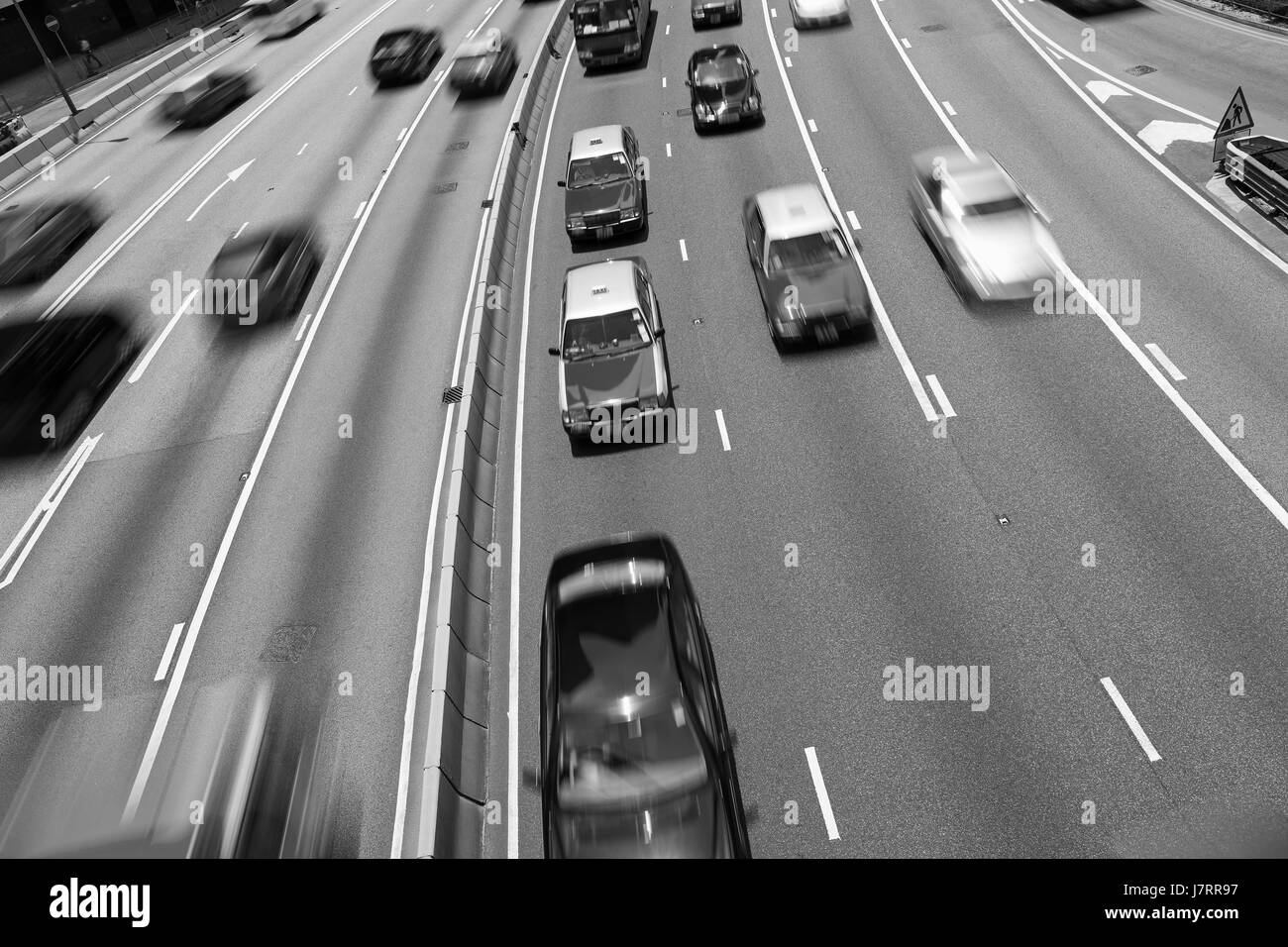 Traffic on multiple lane highway with motion blur (Black and White) - Stock Image