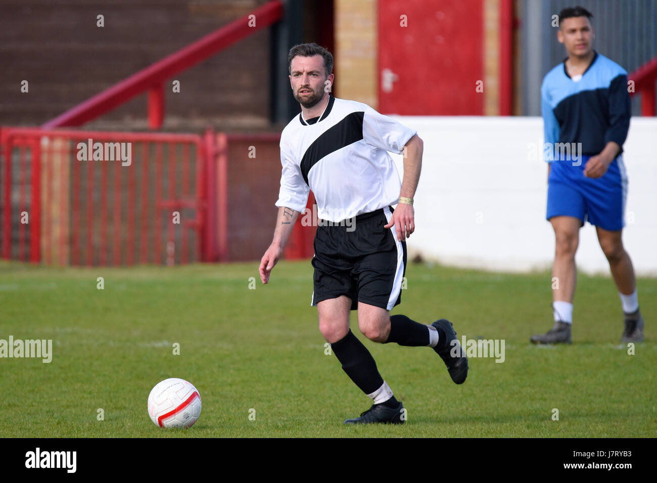 Rocky Sivell playing in a charity football match in Dagenham. Space for copy - Stock Image