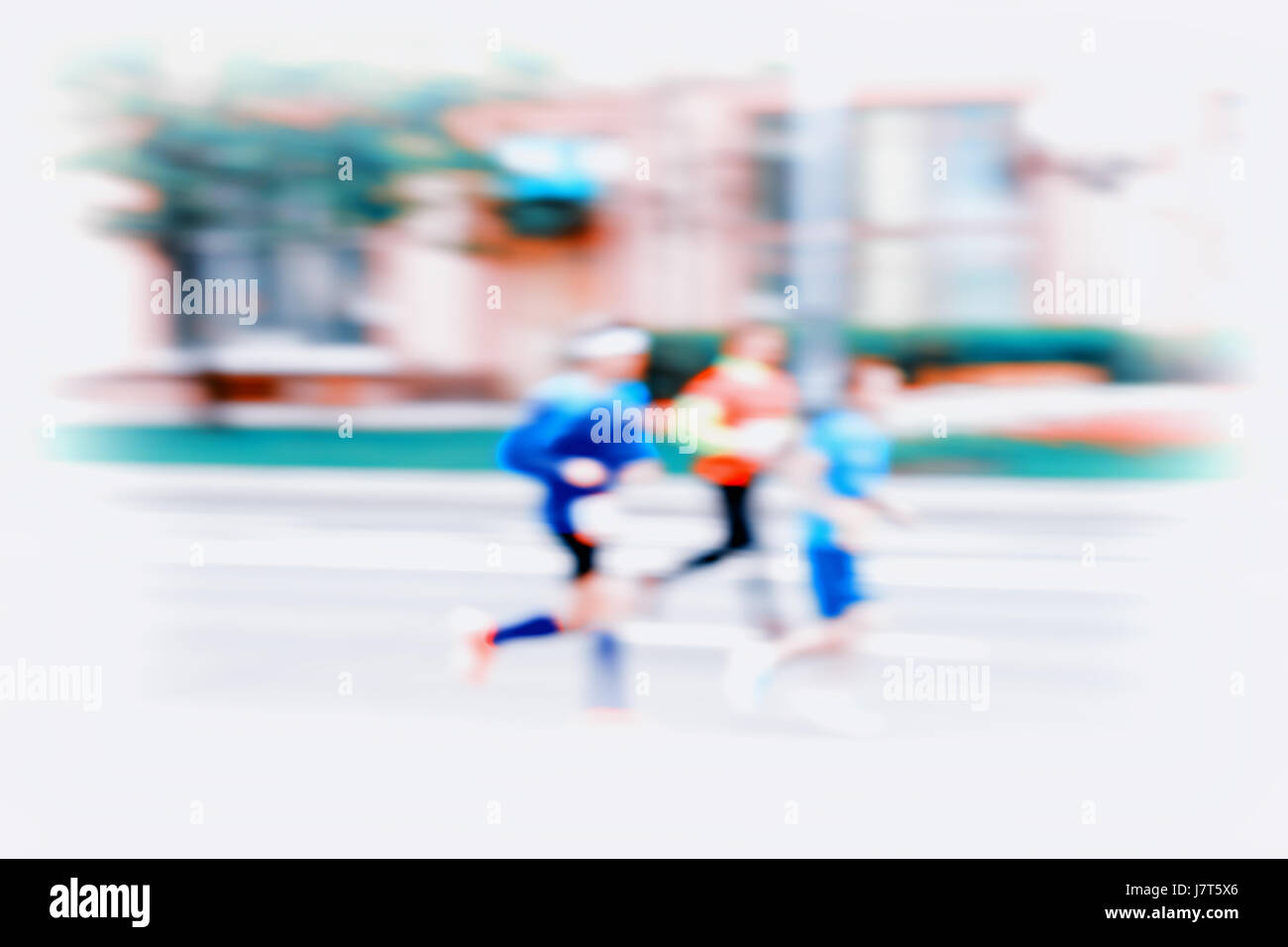 Group of three young runners in moving, blur effect, unrecognizable faces. City marathon. Sport, fitness and healthy - Stock Image
