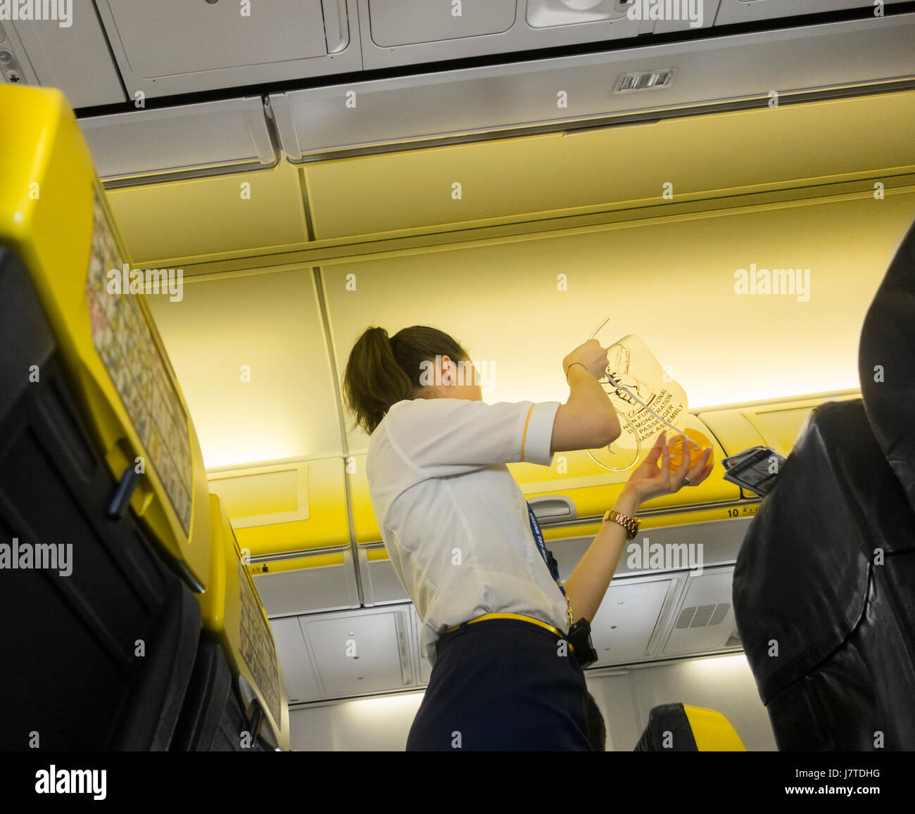 Ryanair pre flight safety demonstration - Stock Image