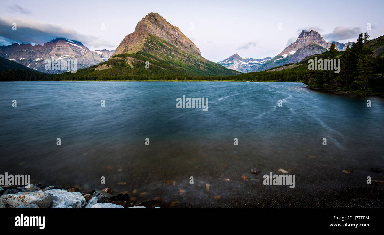 Many Glacier Glacier National Park Mountain Landscapes Sunrise Swiftcurrent lake Grinnell Point - Stock Image
