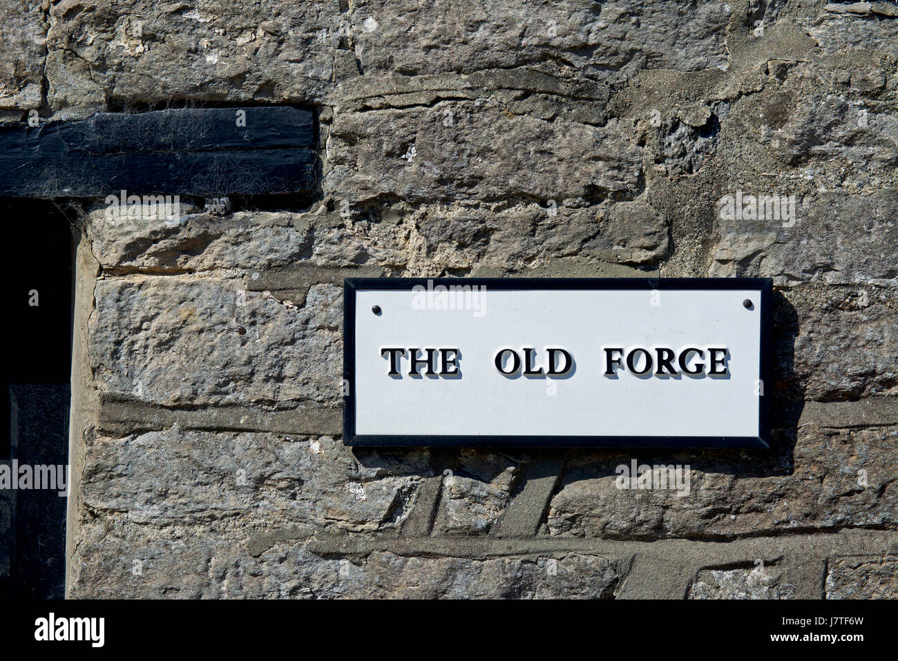 House called The Old Forge, England UK - Stock Image