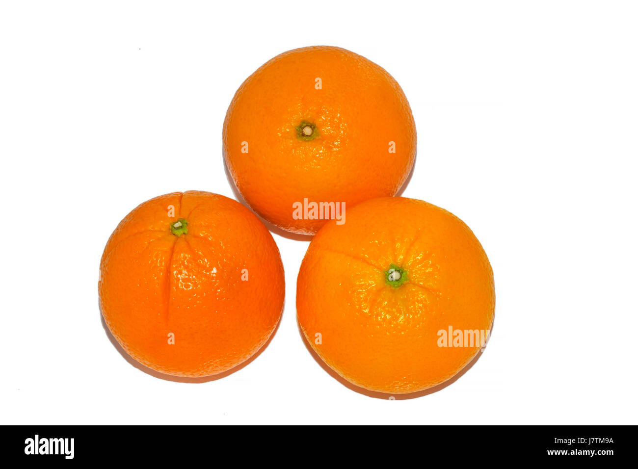 Three whole oranges isolated on white background - Stock Image
