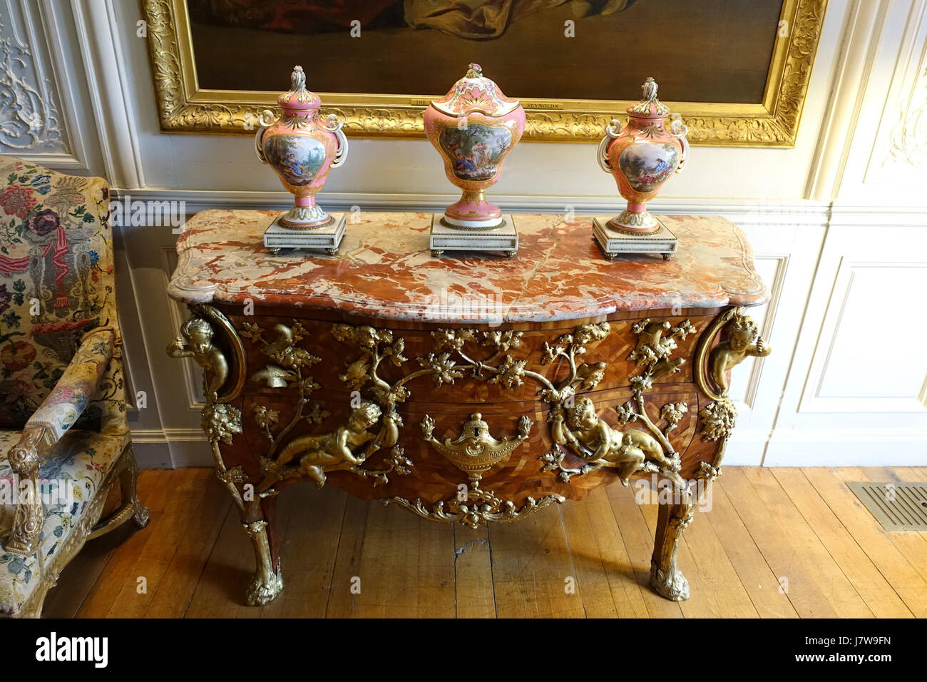 Chest of drawers by Charles Cressent, Paris, c. 1730, with Sevres porcelain   Waddesdon Manor   Buckinghamshire, - Stock Image