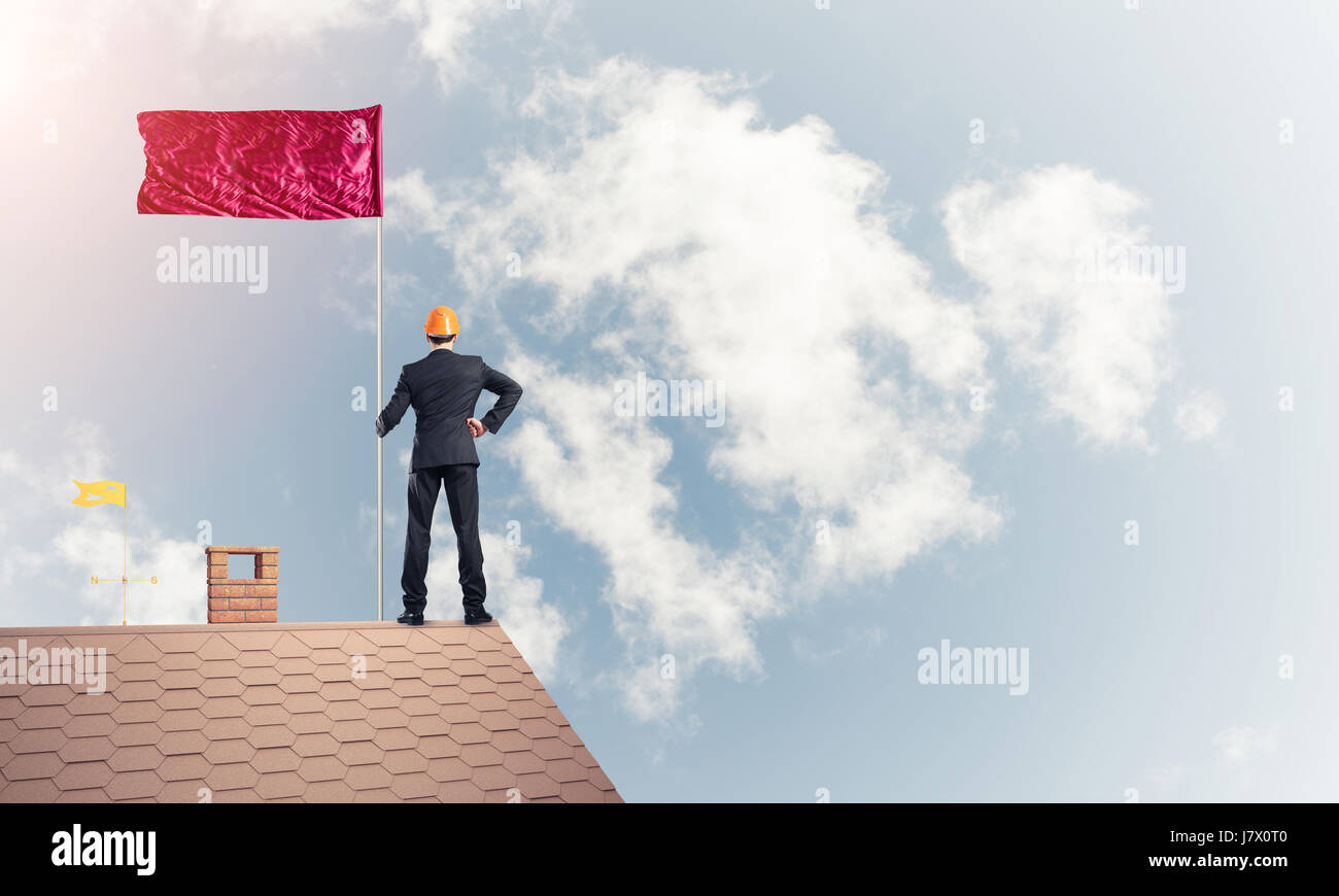 Young businessman with flag presenting concept of leadership. Mi - Stock Image