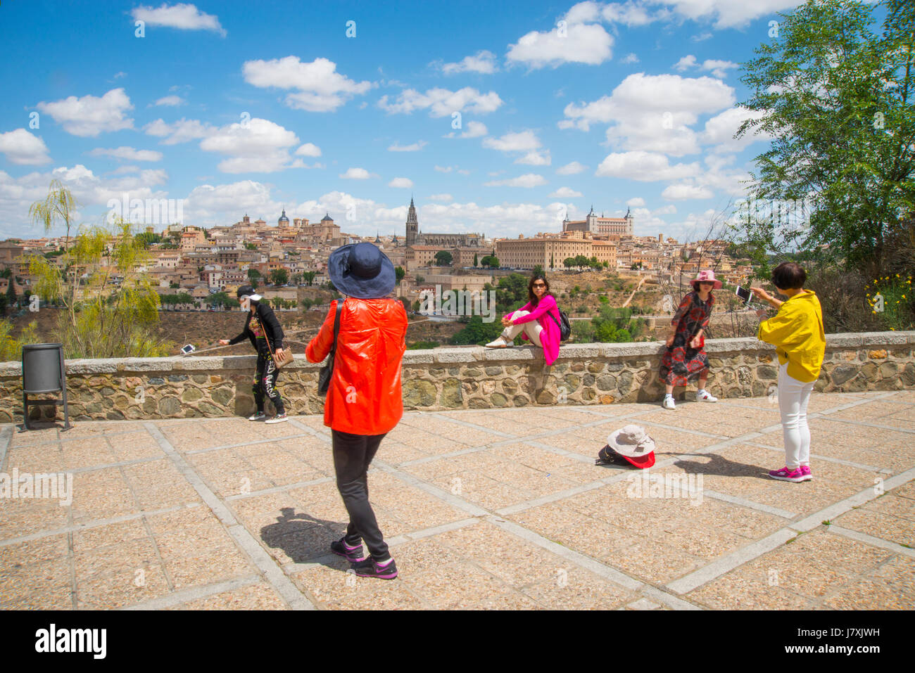 Group of Japanese women taking photos at the viewpoint. Toledo, Spain. - Stock Image