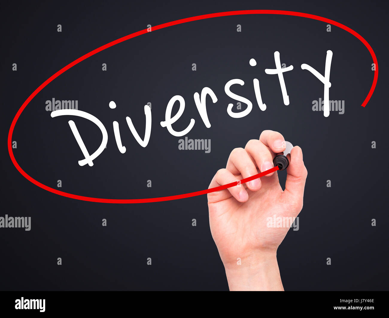 Man Hand writing Diversity with marker on transparent wipe board. Isolated on black. Business, internet, technology - Stock Image