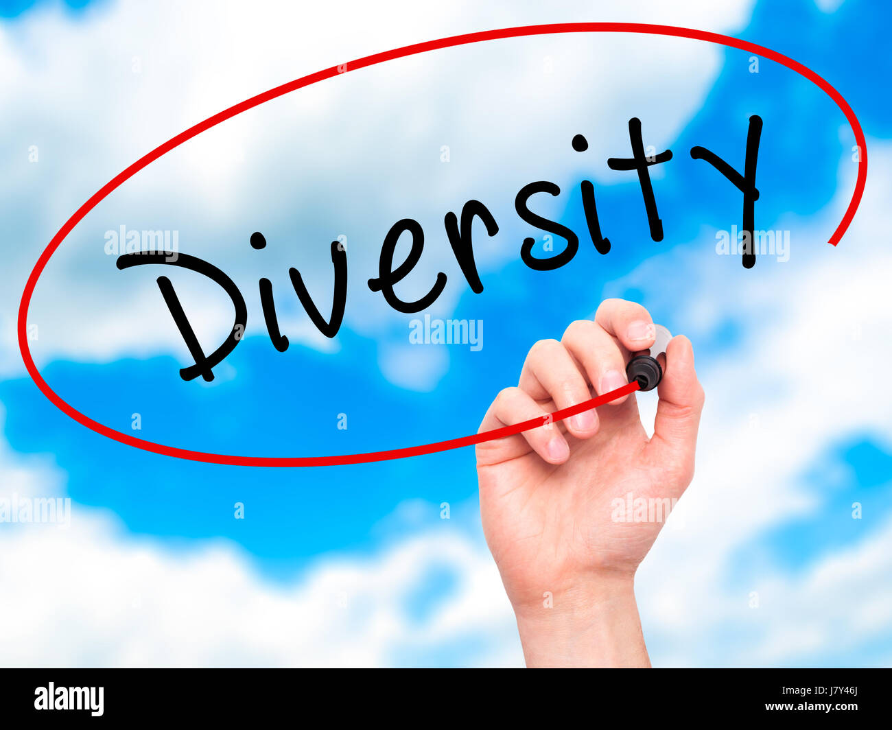 Man Hand writing Diversity with marker on transparent wipe board. Isolated on sky. Business, internet, technology - Stock Image