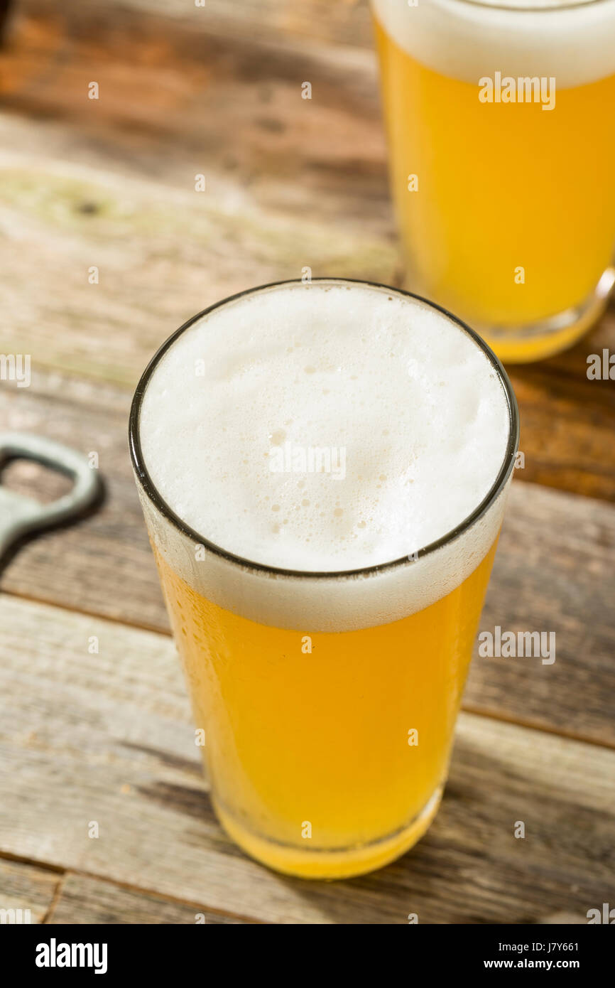 Light Refreshing Summer Craft Beer in a Pint Glass - Stock Image