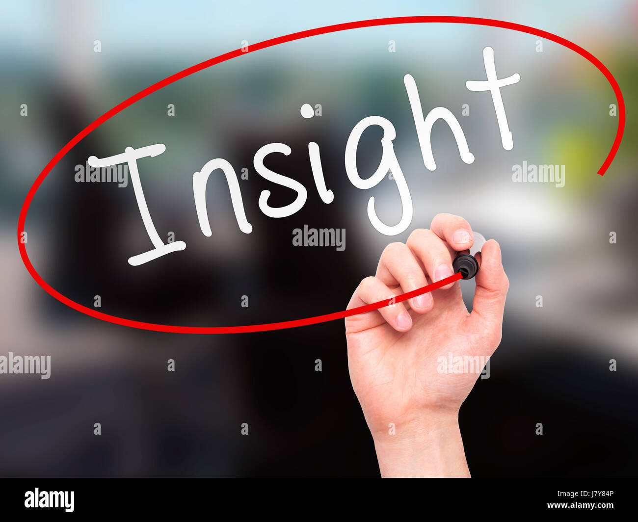 Man Hand writing Insight with marker on transparent wipe board. Isolated on office. Business, internet, technology Stock Photo