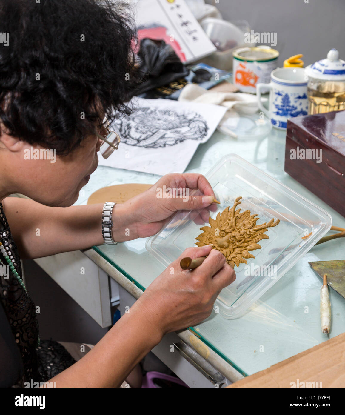 Wenzhou, Zhejiang, China.  Artist Crafting Mythological Figure, Arts and Crafts Research  Institute. - Stock Image