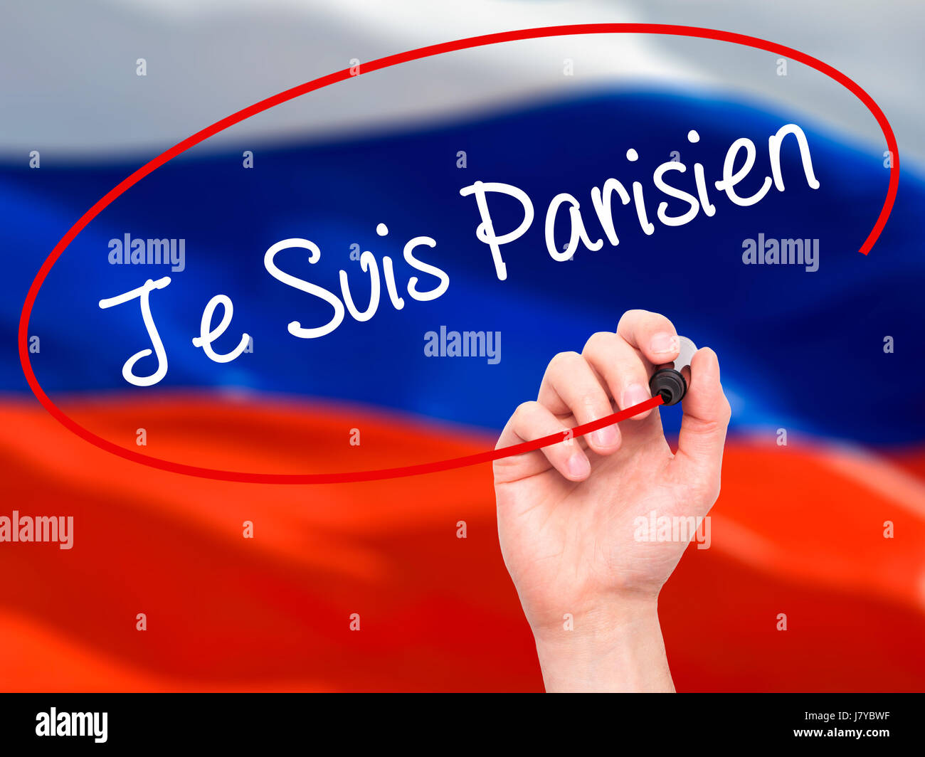 Man Hand writing Je Suis Parisien with black marker on visual screen. Isolated on flag. Stock Photo Stock Photo