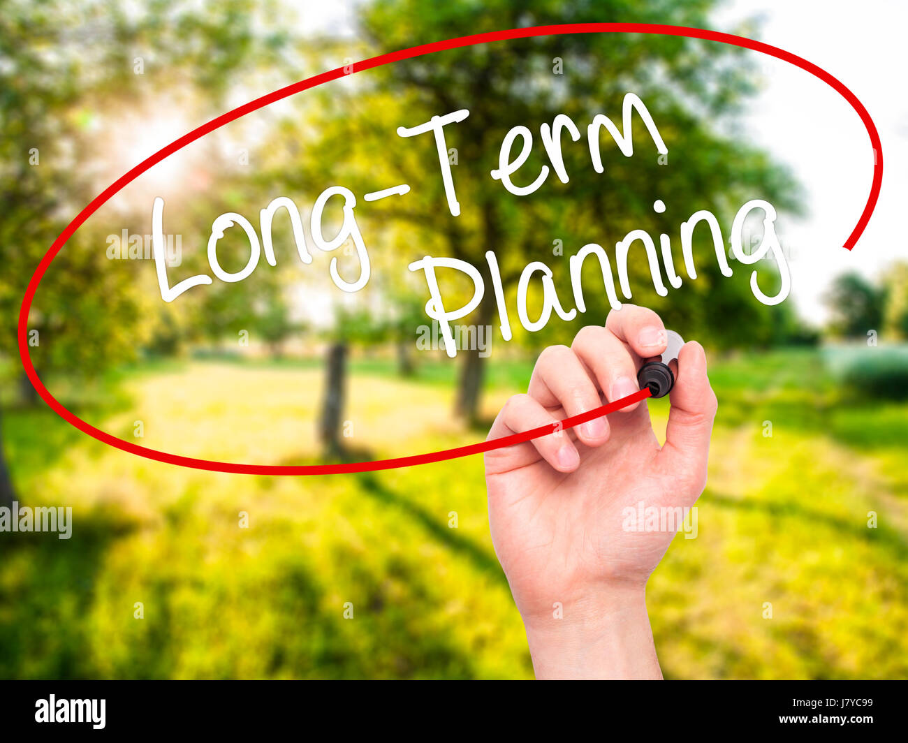 Man Hand writing  Long-Term Planning with black marker on visual screen. Isolated on background. Business, technology, - Stock Image