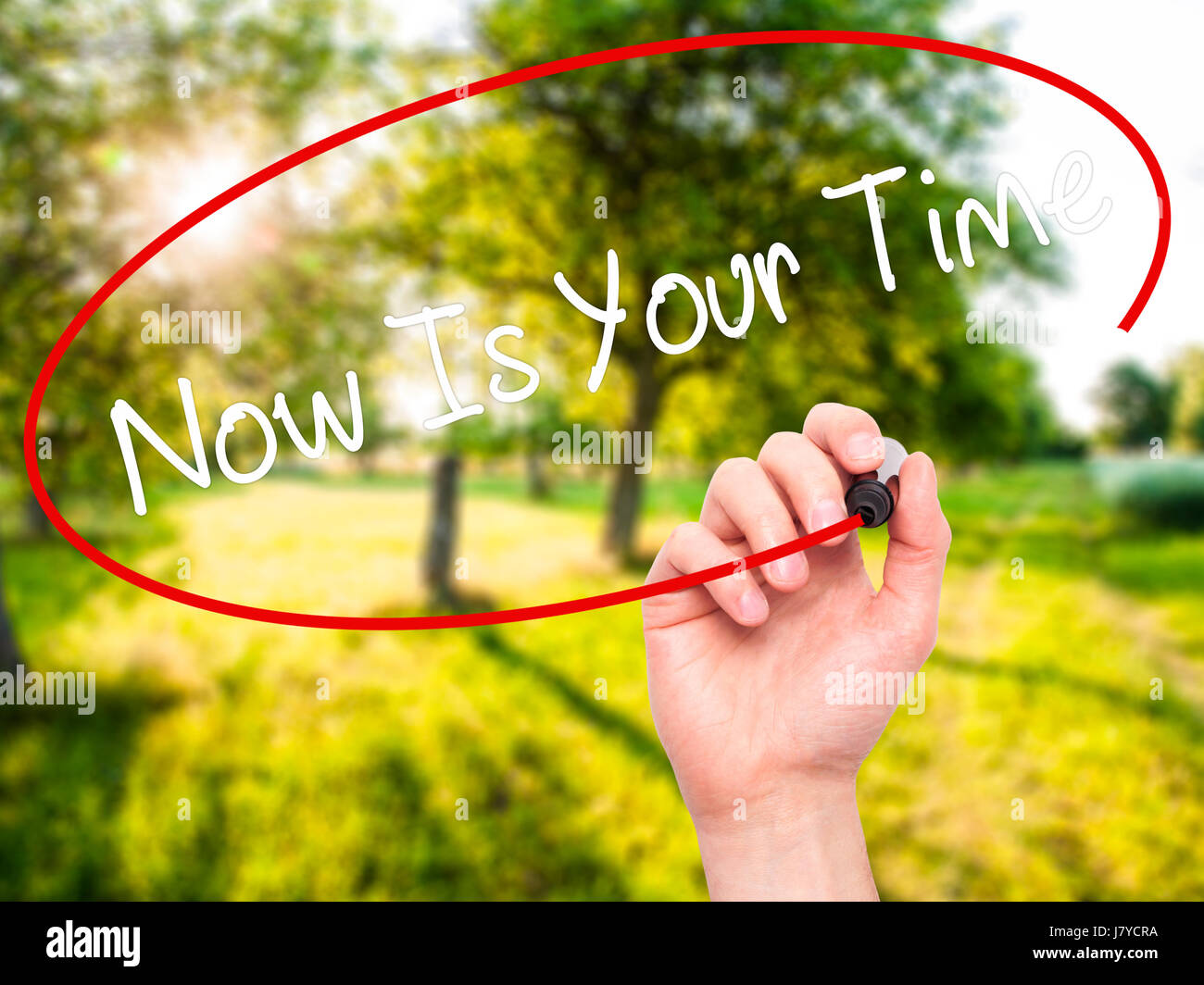 Man Hand writing Now Is Your Time  with black marker on visual screen. Isolated on nature. Business, technology, - Stock Image