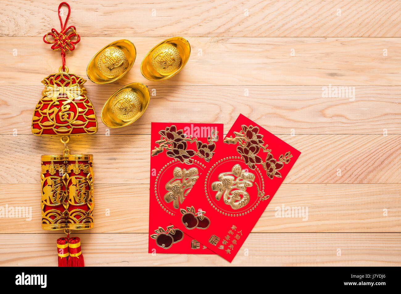 Top View Gold And Red Chinese New Year Decoration On Wooden Stock