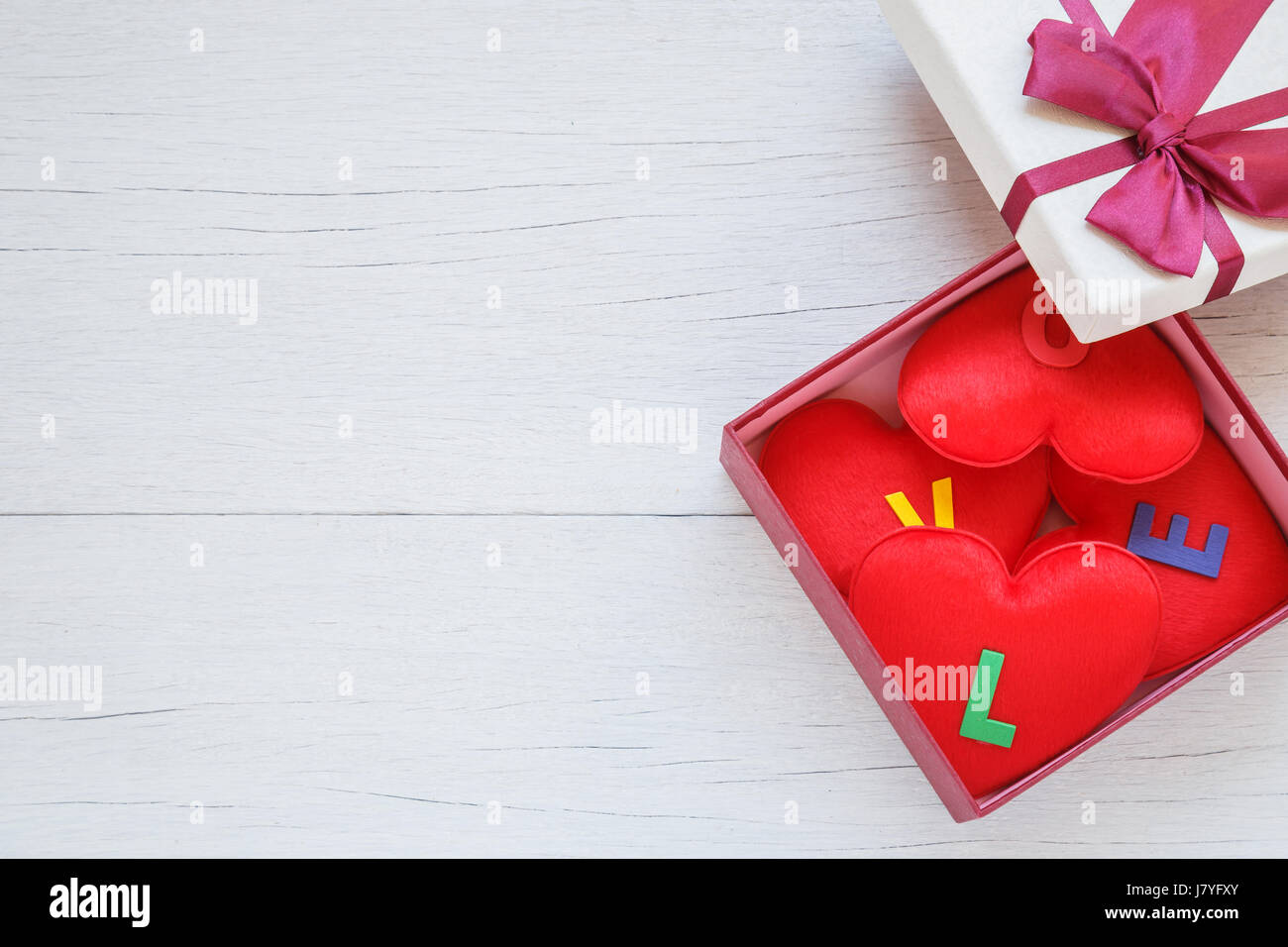 Top View Red Heart Shape With Love Word In Gift Box With Ribbon On White Wooden Plank Background For Love Or Valentine Day Concept