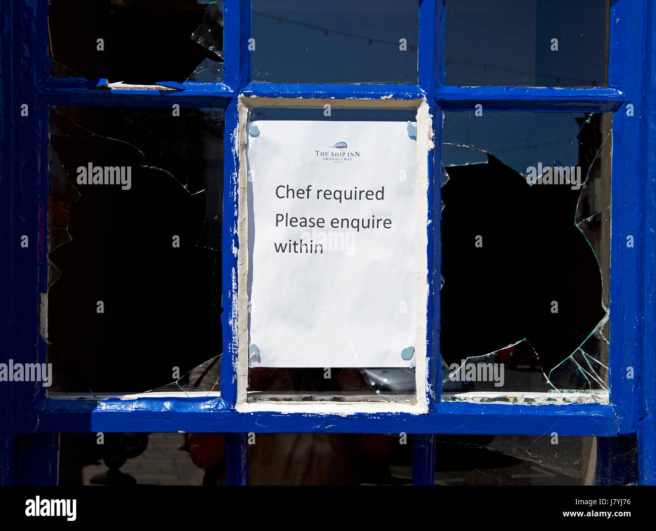 Sign on broken window: chef required, England UK - Stock Image