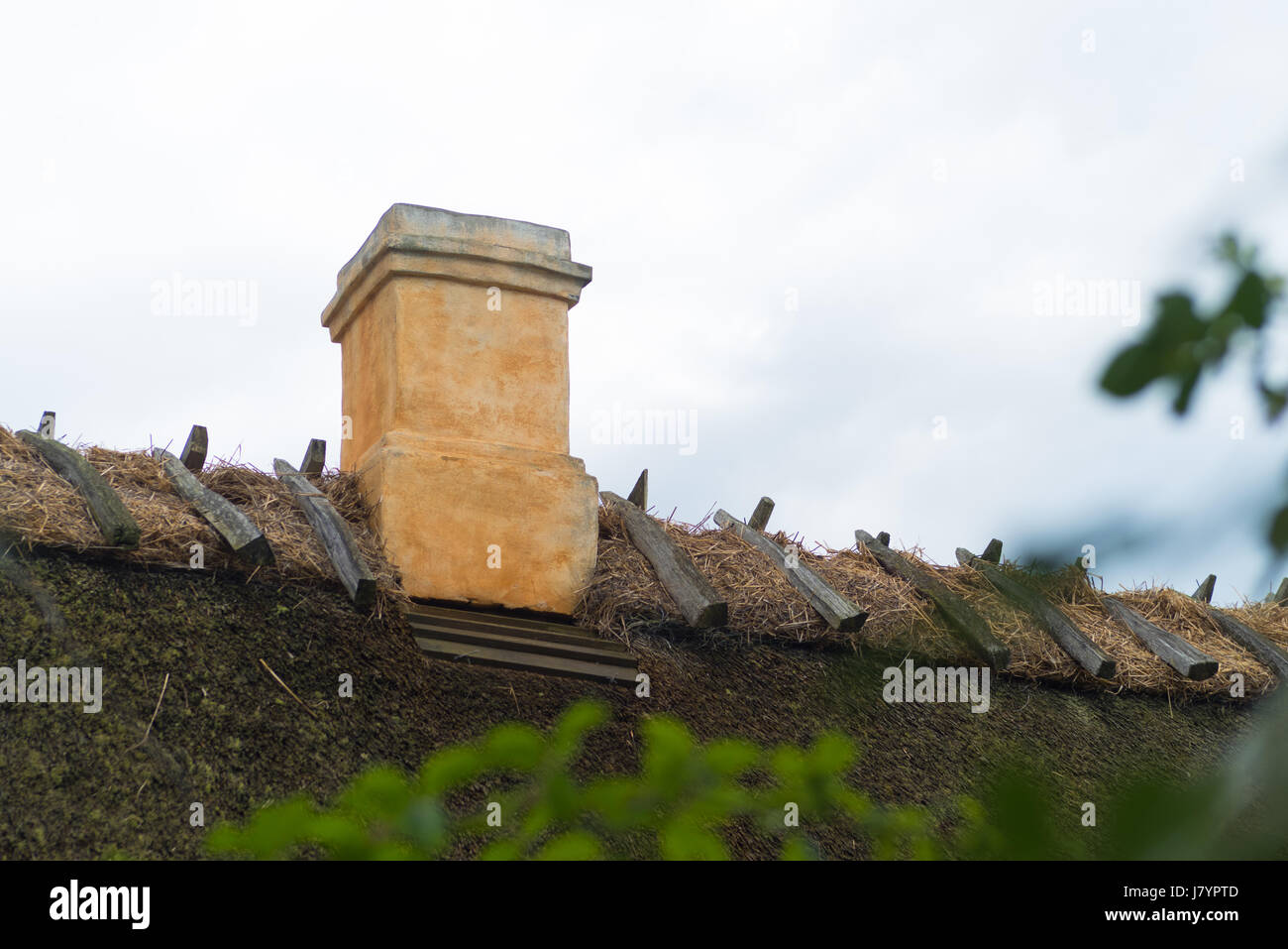 typical thatched roof with chimney in the old fishermen's village of Kikhavn - Stock Image