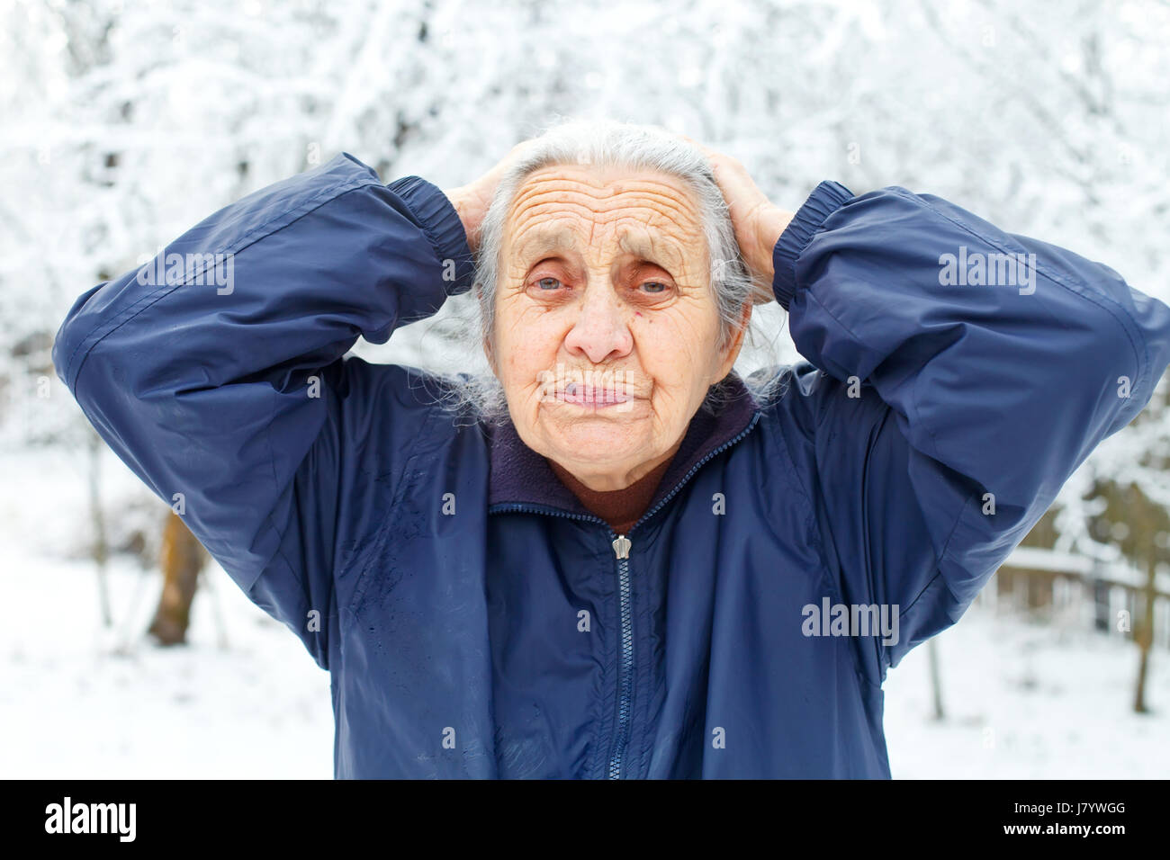 Picture of an old woman having a headache - Stock Image