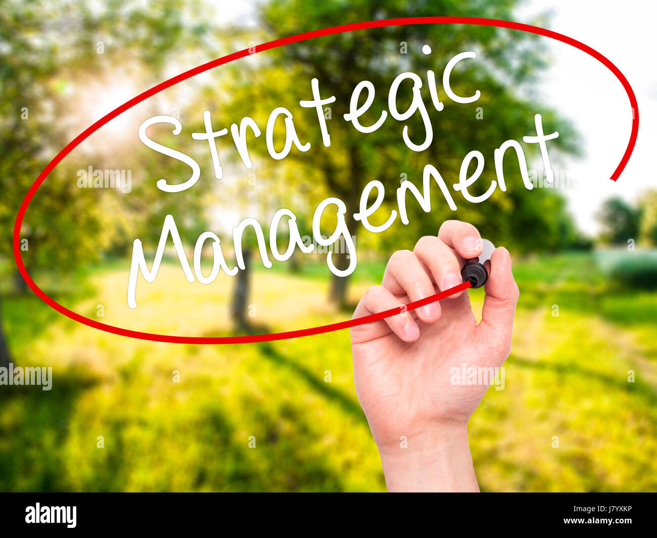 Man Hand writing Strategic Management with black marker on visual screen. Isolated on background. Business, technology, - Stock Image