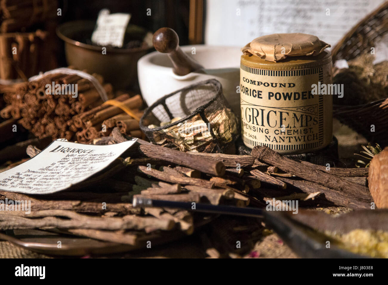 Traditional victorian apothecary's, counter with spices, herbs, pestle and mortar still life (Old Operating - Stock Image